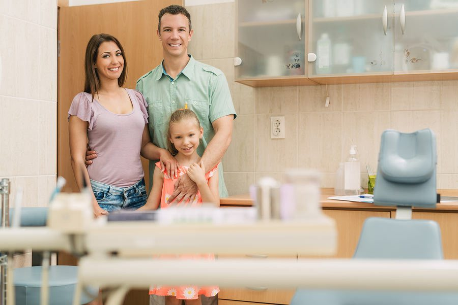 A family visiting the dentist studio