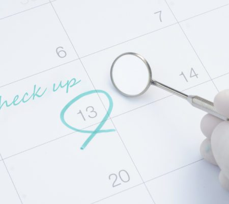 A note of a dentist check up on calendar