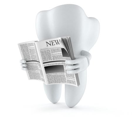 Tooth character reading newspaper on white background
