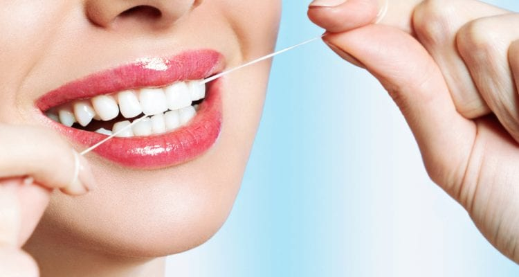 Beautiful young woman smiles. Dental health background