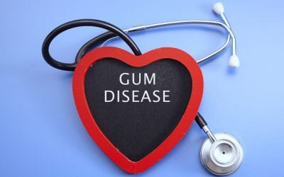 Stethoscope and red love with medical conceptual text-gum disease