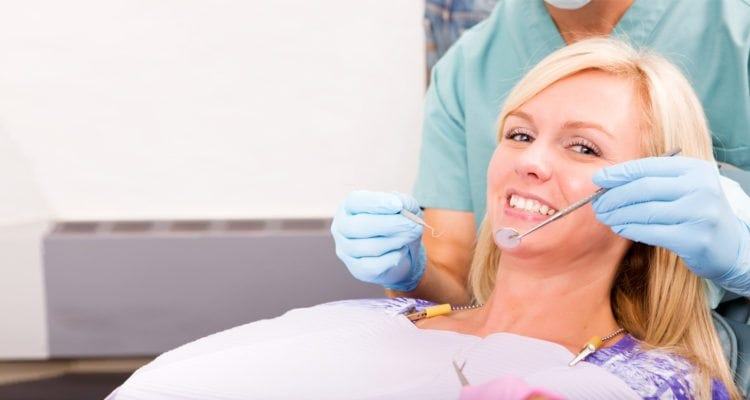Close up woman sitting on a dental chair